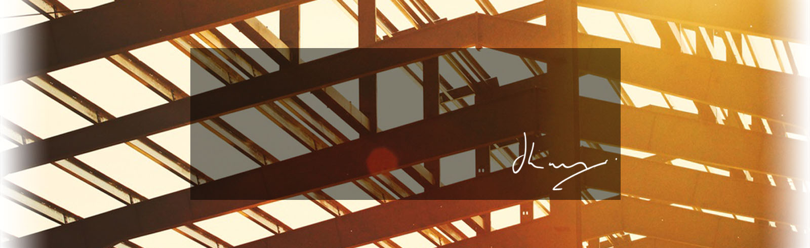 Construction beams with sunshine coming through with signature of James Law, client of Hodgsons Chartered Accountants in Cornwall